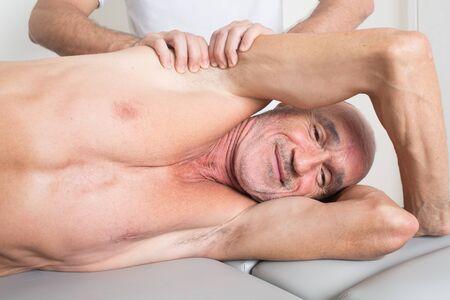 myofascial: Massage therapist giving a back massage