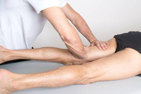 therapist: massage therapist working Stock Photo