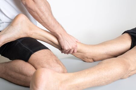 myofascial: physical therapist applying myofascial therapy Stock Photo