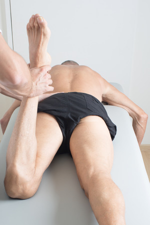 physical therapist applying myofascial therapy photo