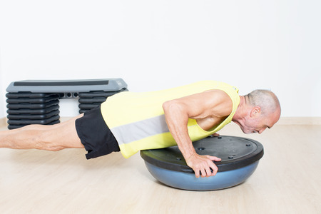 senior with bosu exercise