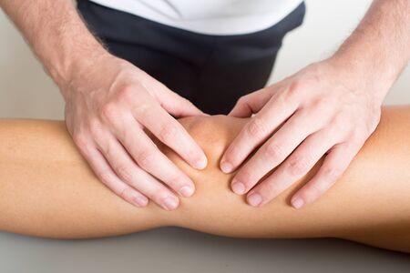quadriceps: knee massage Stock Photo