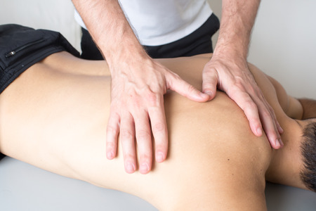 spinal adjustment: cervical manipulation Stock Photo