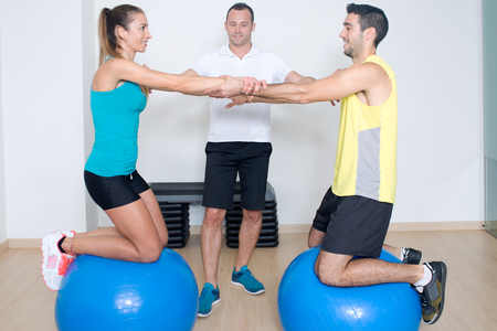 strenghten: Balance training on fitness ball Stock Photo