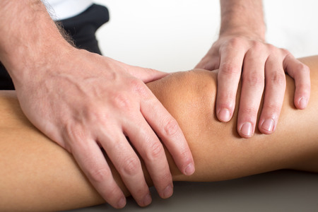acupressure hands: knee massage Stock Photo