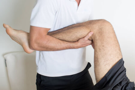 Osteopathy treat leg Stock Photo