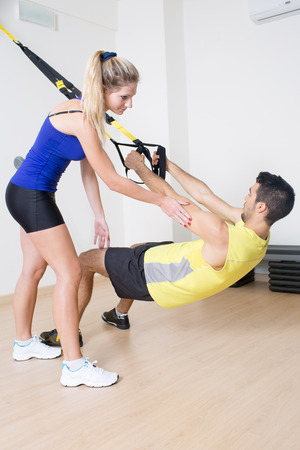 strenghten: Sexy female coach helps with functional training exercise