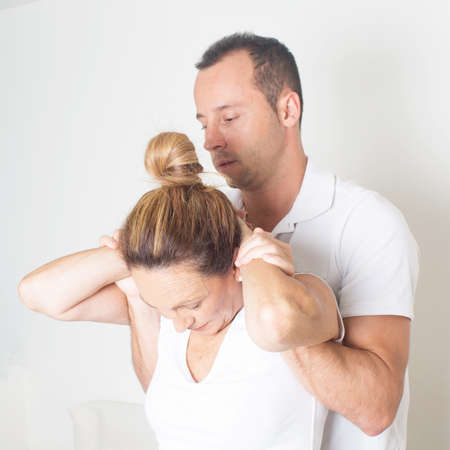 adjustment: Chiropractic care with elderly woman