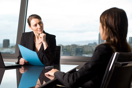 during: Female candidate during a job interview Stock Photo