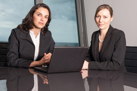 the place is important: two businesswomen in a darker office