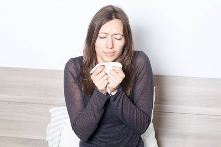 hanky: woman sick in bed having flu