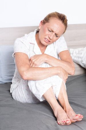 stomachache woman: Elderly woman with stomachache Stock Photo