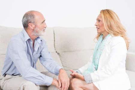 neutral: Elderly couple talking neutral