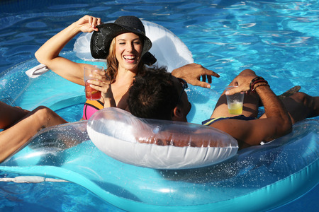 pool party: Beautiful woman during a party in a swimming pool
