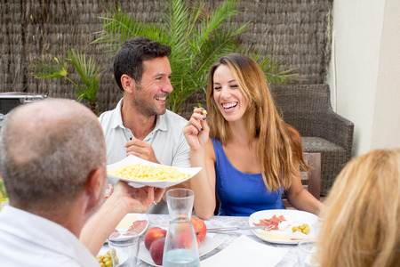 eating dinner: Happy couple during lunch