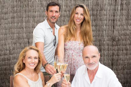 dad son: Family drinking champagne in garden