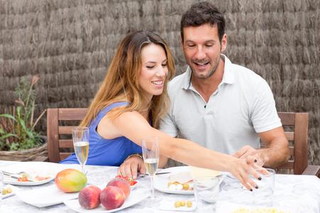 solace: Happy couple having food in garden