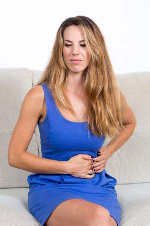 ache: Attractive woman suffering from stomachache Stock Photo