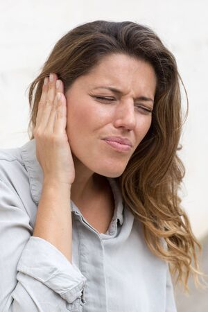 conductive: Attractive woman suffering from ear problems Stock Photo