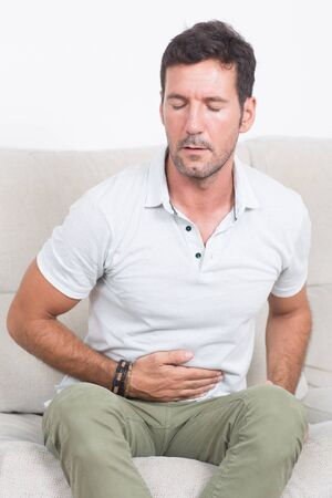 stomachache: man suffering from stomachache