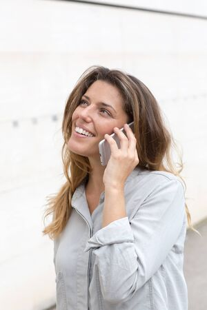 counsel: Happy woman using the phone Stock Photo