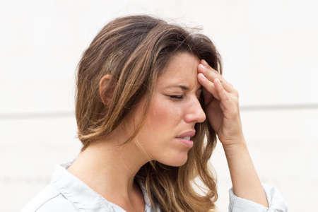 grasp: Pretty woman with a headache Stock Photo
