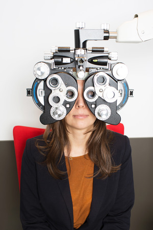 eye care professional: woman during an eye exam
