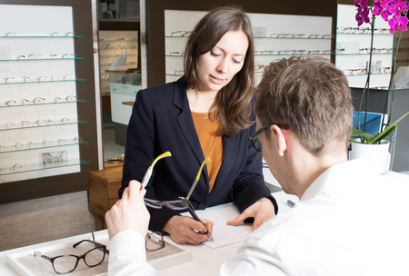 optician: Optician prescribing glasses