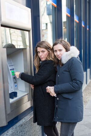 withdraw: Two women withdraw money
