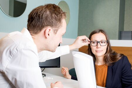 woman trying glasses Stock Photo
