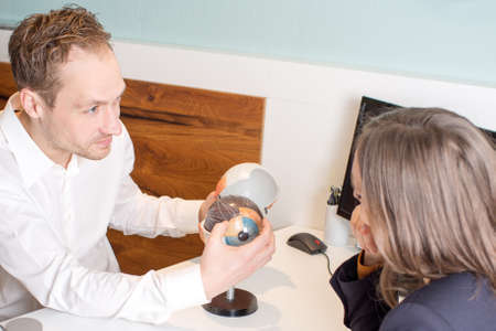 optician: Optician explaining eye structure Stock Photo