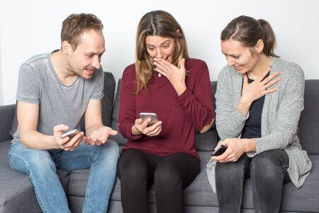 mockery: friends sharing a secret Stock Photo