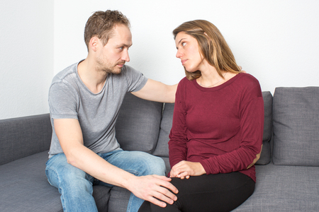 being: Attractive woman being sad with partner Stock Photo