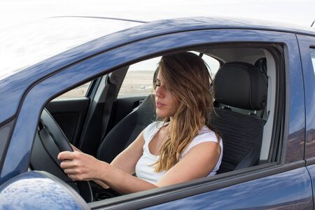 asleep: Woman tired at the wheel