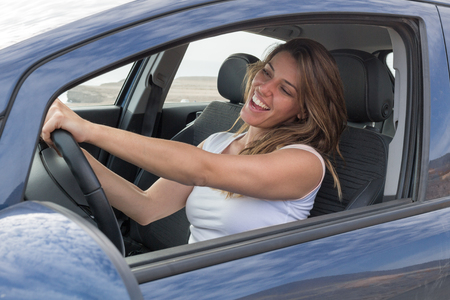 Attractive woman in car singing