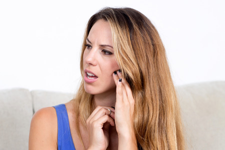 toothache: Pretty blonde woman with toothache