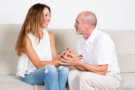 younger: Senior man with younger woman Stock Photo