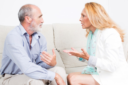 feelings and emotions: Fight between seniors Stock Photo