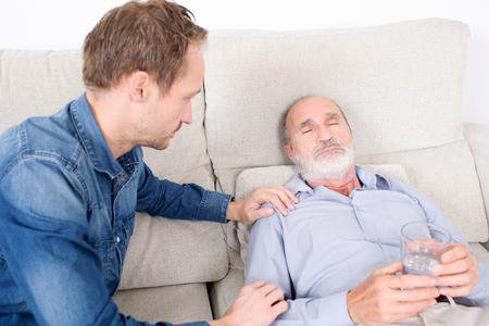 Receiving: Elderly man receiving some medicine