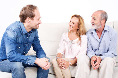 younger: happy elderly couple talking with a younger man