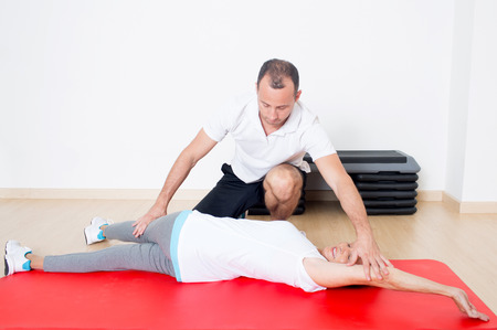 regularly: Personal trainer helping