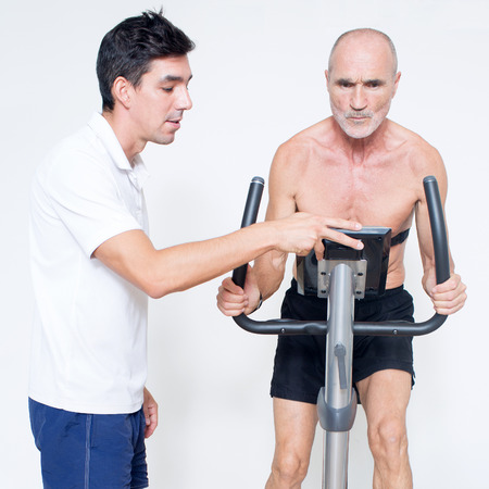 Personal trainer monitoring spinning exercise