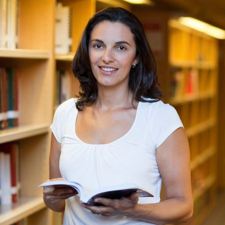 adult student: Attractive latin woman in the library Stock Photo