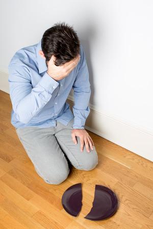 Man unhappy over a broken plate photo