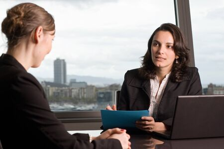 Tax consultant in conversation with customers photo