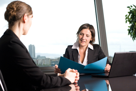 Financial adviser talking with a client in bank building photo
