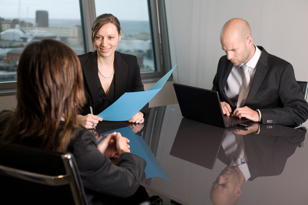 Job interview with two persons from a human resources team and a candidate photo