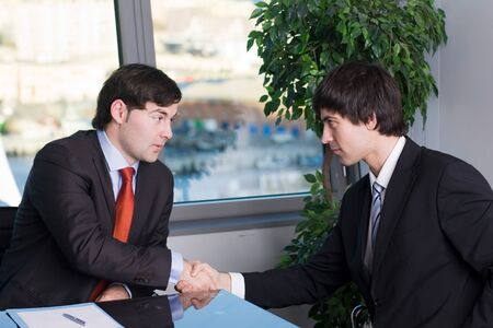 Business people handshake over a deal photo