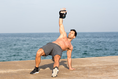 kettlebell exercise by the sea