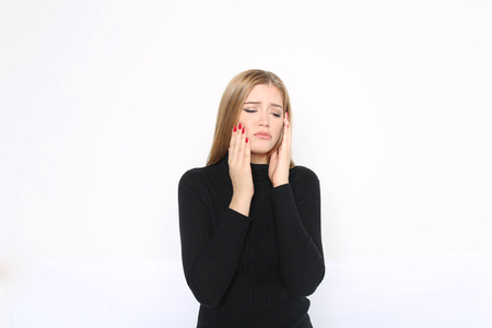 Beautiful blond woman having toothache Stock Photo